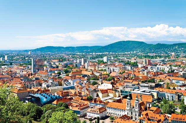 You can ascend the city pinnacle of Graz, Austria, via countless steps for a spectacular view of the red-tiled roofs below – or you can ascend via elevator within the mountain.