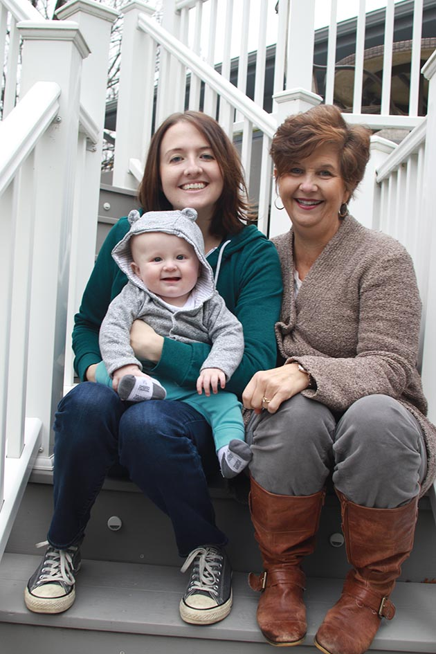 Mary Rose Remington and her daughter, Laura Groenjes Mitchell, pose with Mitchell's son, Kellan, photographed at 7 months old.