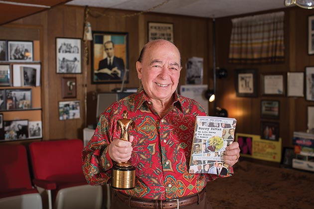 Barry ZeVan holds his new book and a Telly Award, bestowed on him in 2006 for executive producing the documentary American Indian Homelands: Matters of Truth, Honor and Dignity Immemorial, narrated by former news anchor Sam Donaldson.