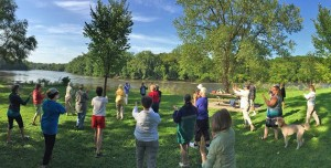 During the summer months, Becketwood residents practice t'ai chi chih at Hidden Falls Regional Park in St. Paul. Photo by Don Darnutzer
