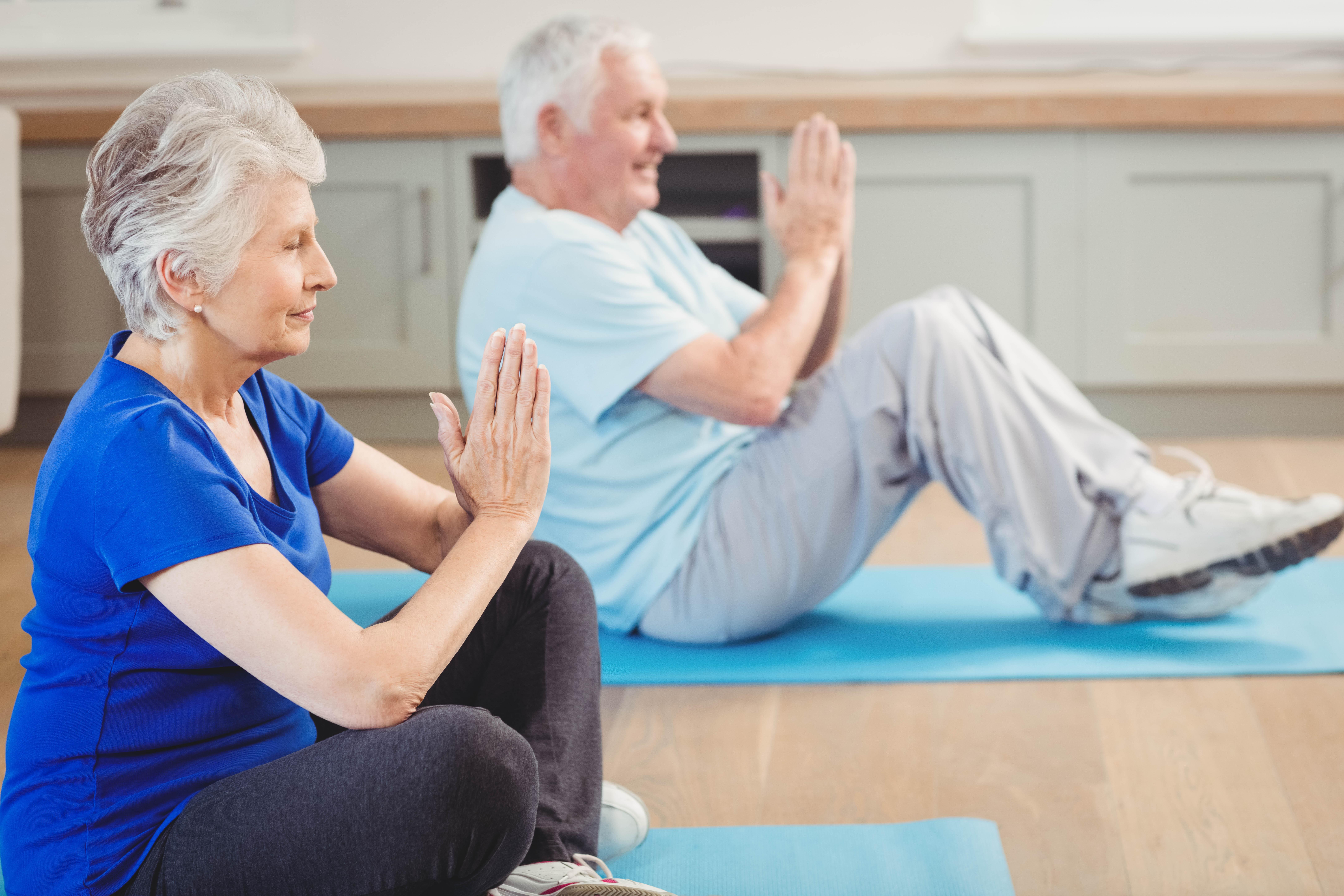 Seniors doing yoga