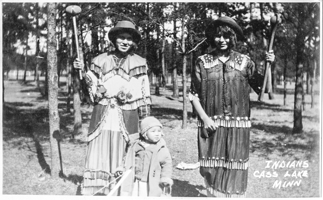 Ojibwe women wearing jingle dresses